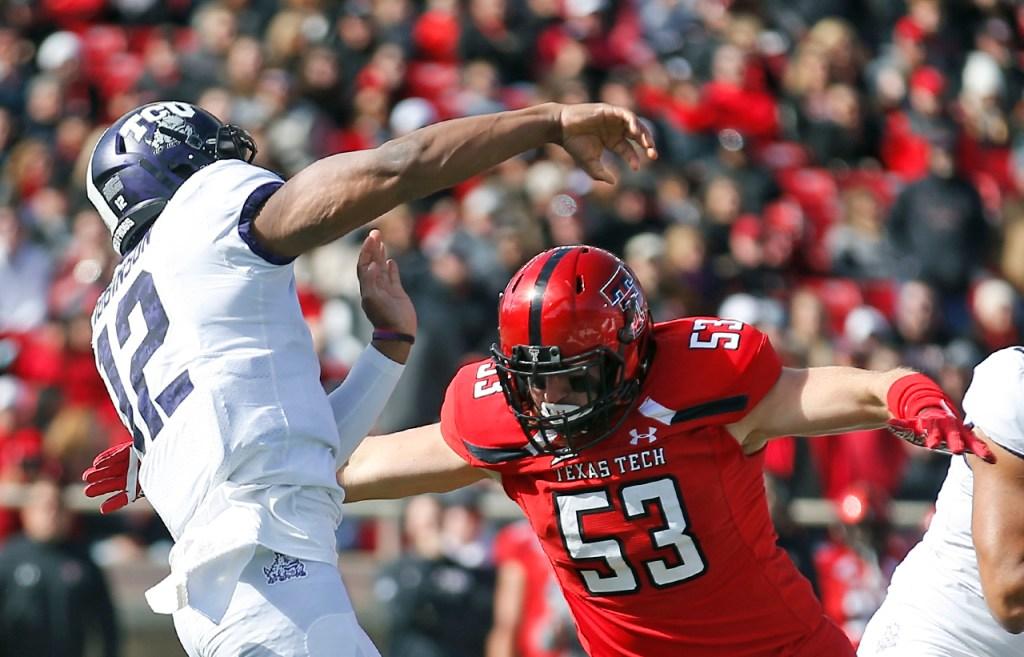 Texas Tech's Eli Howard tackles TCU's Shawn Robinson