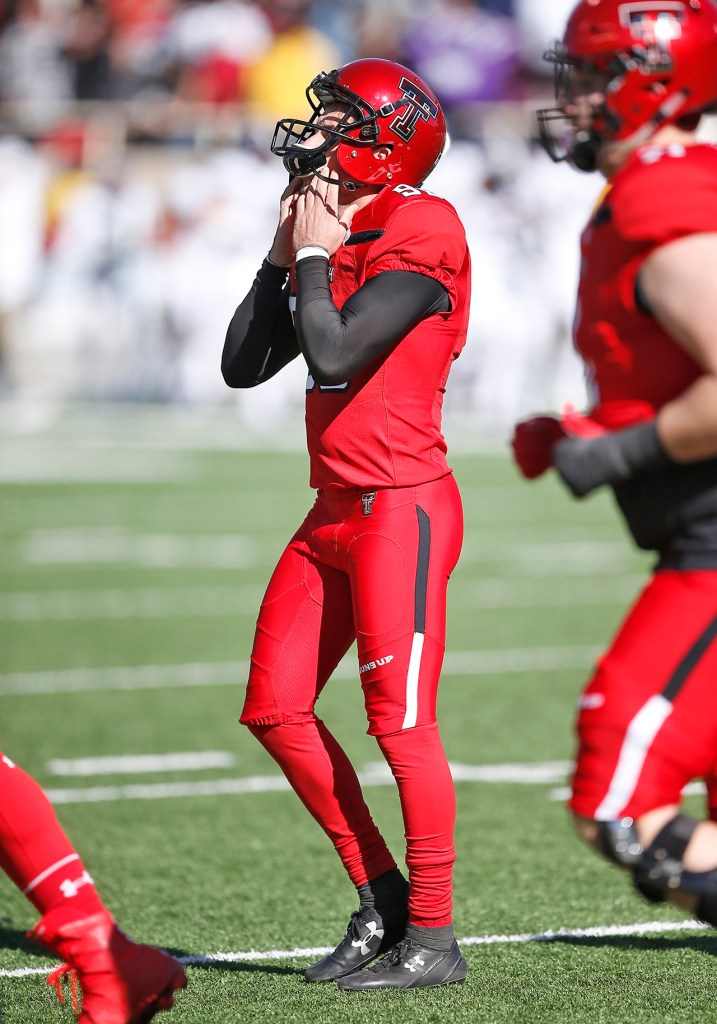 Texas Tech's Clayton Hatfield covers his face after missing his second field goal