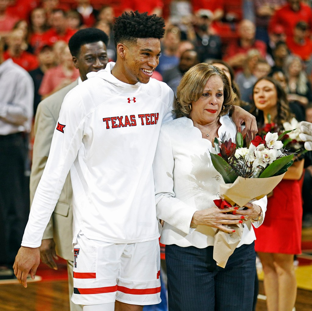 Texas Tech's Justin Gray walks onto the court with his mom during the senior day celebration, Saturday, March 3, 2018, in Lubbock, Texas. (AP Photo/Brad Tollefson)