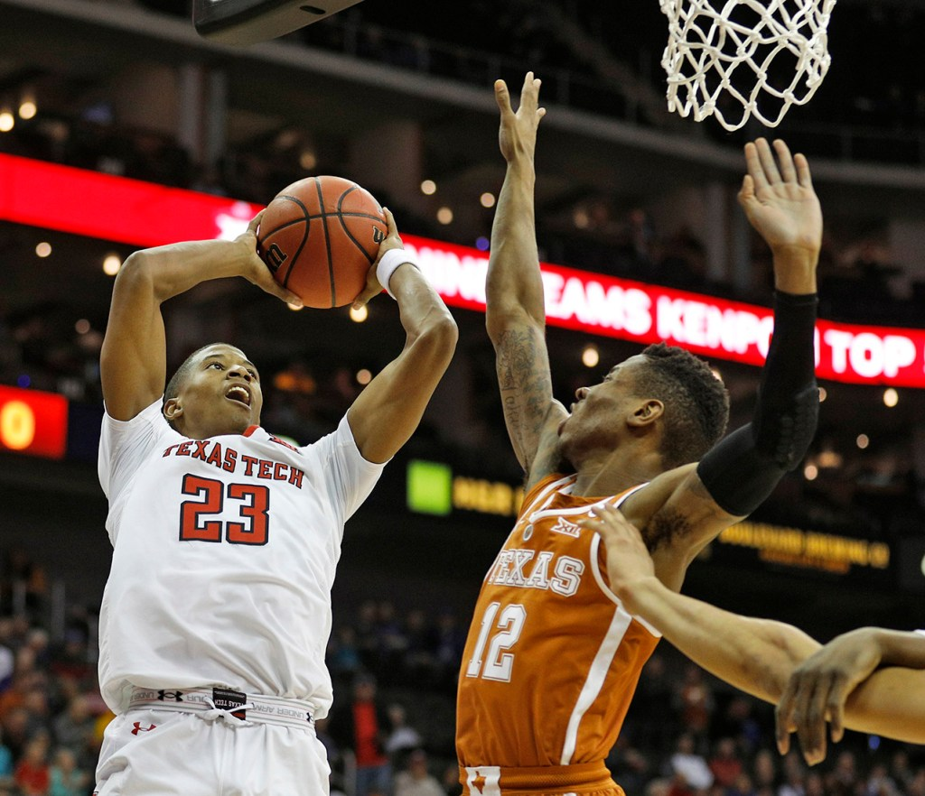 Texas Tech's Jarrett Culver (23) shoots the ball around Texas' Kerwin Roach (12) during a Big 12 basketball tournament game Thursday, March 8, 2018, at the Sprint Center in Kansas City, Mo. [Brad Tollefson/A-J Media]