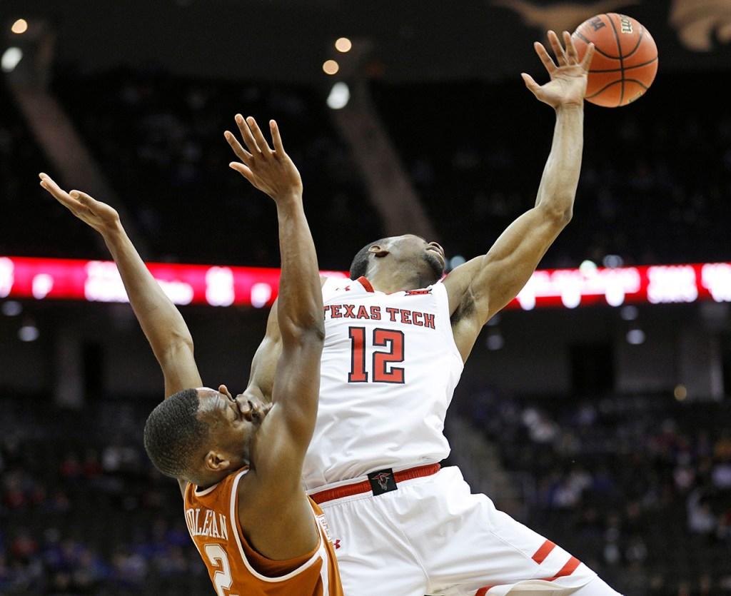 Texas Tech's Keenan Evans (12) loses the ball after Texas' Matt Coleman (2) knocks it away during a Big 12 basketball tournament game Thursday, March 8, 2018, at the Sprint Center in Kansas City, Mo. [Brad Tollefson/A-J Media]
