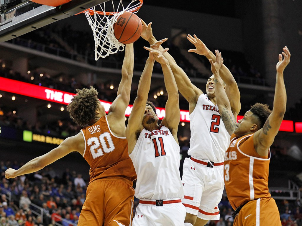 Texas Tech's Zach Smith (11), Zhaire Smith (2), Texas' Jericho Sims (20) and Jacob Young (3) try to rebound the ball during a Big 12 basketball tournament game Thursday, March 8, 2018, at the Sprint Center in Kansas City, Mo. [Brad Tollefson/A-J Media]