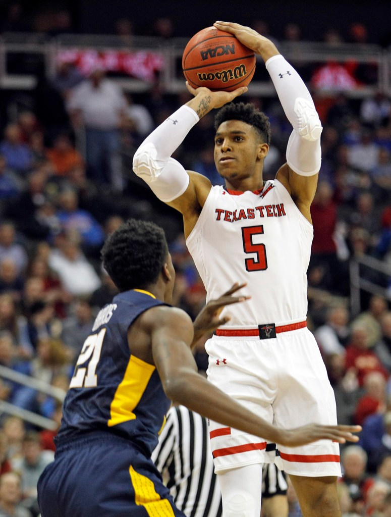 Texas Tech's Justin Gray (5) shoots the ball over West Virginia's Wesley Harris (21) during a Big 12 semifinal game Friday, March 9, 2018, at the Sprint Center in Kansas City, Mo. [Brad Tollefson/A-J Media]