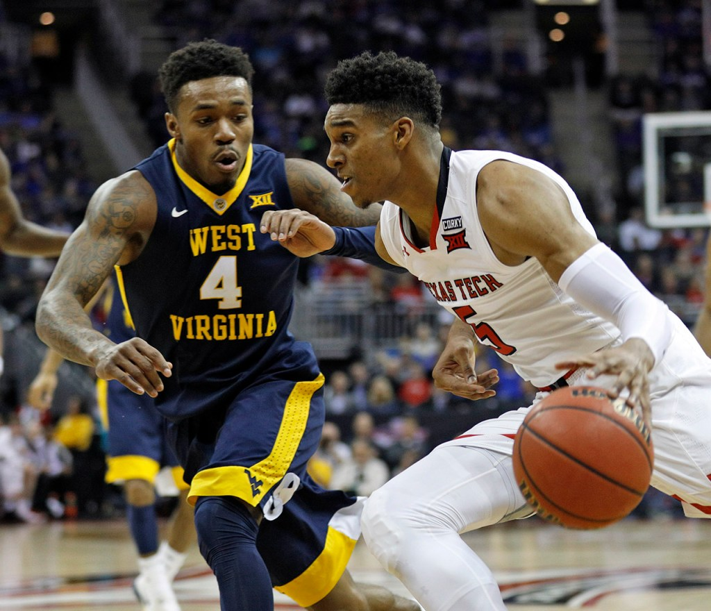 Texas Tech's Justin Gray (5) drives the ball around West Virginia's Daxter Miles (4) during a Big 12 semifinal game Friday, March 9, 2018, at the Sprint Center in Kansas City, Mo. [Brad Tollefson/A-J Media]