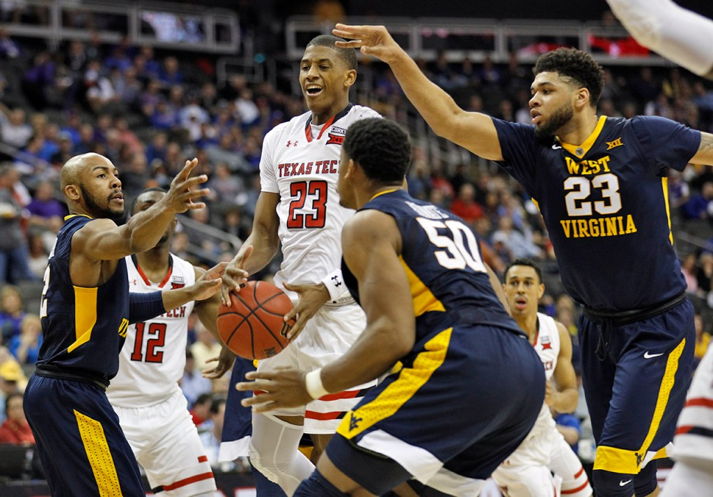 Texas Tech's Jarrett Culver (23) loses control of the ball in front of West Virginia's Jevon Carter (2) during a Big 12 semifinal game Friday, March 9, 2018, at the Sprint Center in Kansas City, Mo. [Brad Tollefson/A-J Media]
