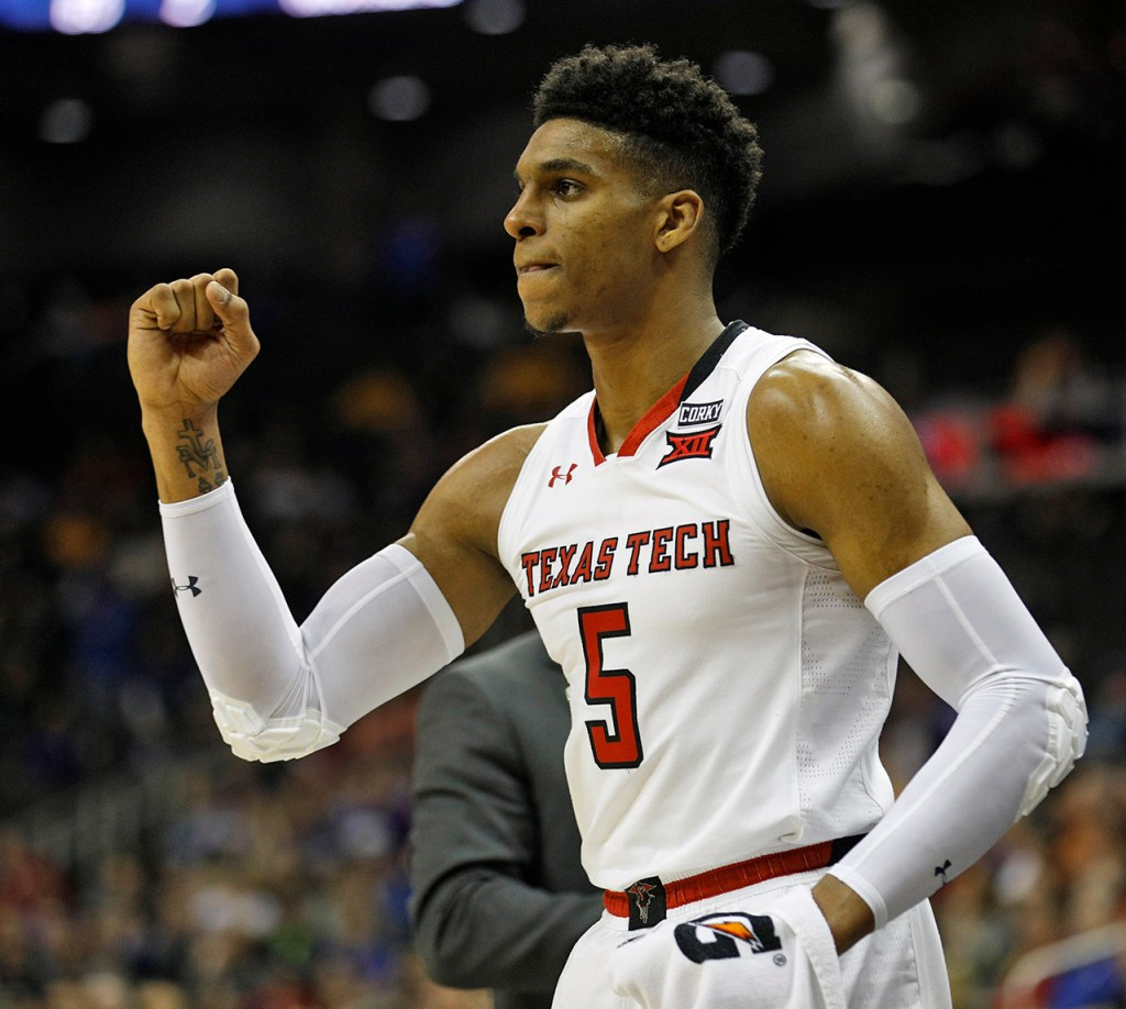 Texas Tech's Justin Gray (5) celebrates after a play during a Big 12 semifinal game against West Virginia, Friday, March 9, 2018, at the Sprint Center in Kansas City, Mo. [Brad Tollefson/A-J Media]