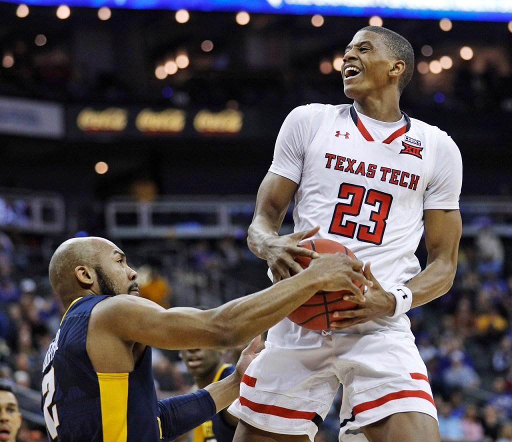 West Virginia's Jevon Carter (2) blocks the shot by Texas Tech's Jarrett Culver (23) during a Big 12 semifinal game Friday, March 9, 2018, at the Sprint Center in Kansas City, Mo. [Brad Tollefson/A-J Media]