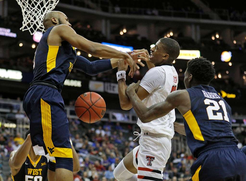 West Virginia's Jevon Carter (2) and Wesley Harris (21) block a shot by Texas Tech's Jarrett Culver (23) during a Big 12 semifinal game Friday, March 9, 2018, at the Sprint Center in Kansas City, Mo. [Brad Tollefson/A-J Media]