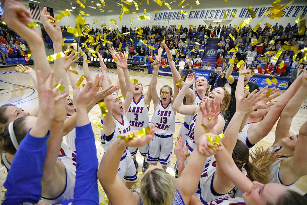 Lubbock Christian players celebrate after winning the South Central regional championship against West Texas A&M, Monday, March 12, 2018, at Rip Griffin Center in Lubbock, Texas. [Brad Tollefson/A-J Media]