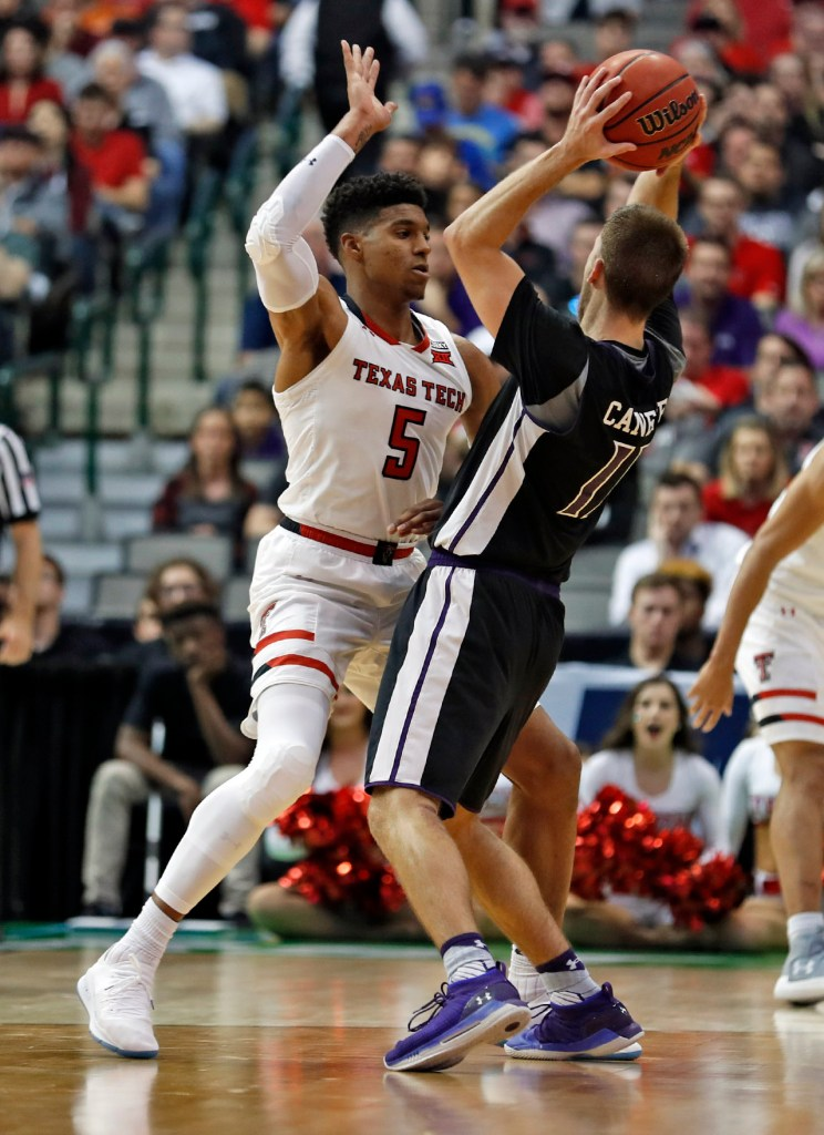 Texas Tech's Justin Gray (5) defends Stephen F. Austin's Ivan Canete (11) during an NCAA college basketball tournament first-round game Thursday, March 15, 2018, at American Airlines Center in Dallas, Texas. [Brad Tollefson/A-J Media]