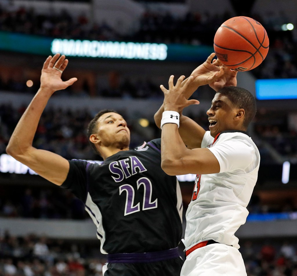 Texas Tech's Jarrett Culver (23) loses the ball as it's knocked away by Stephen F. Austin's TJ Holyfield (22) during an NCAA college basketball tournament first-round game Thursday, March 15, 2018, at American Airlines Center in Dallas, Texas. [Brad Tollefson/A-J Media]