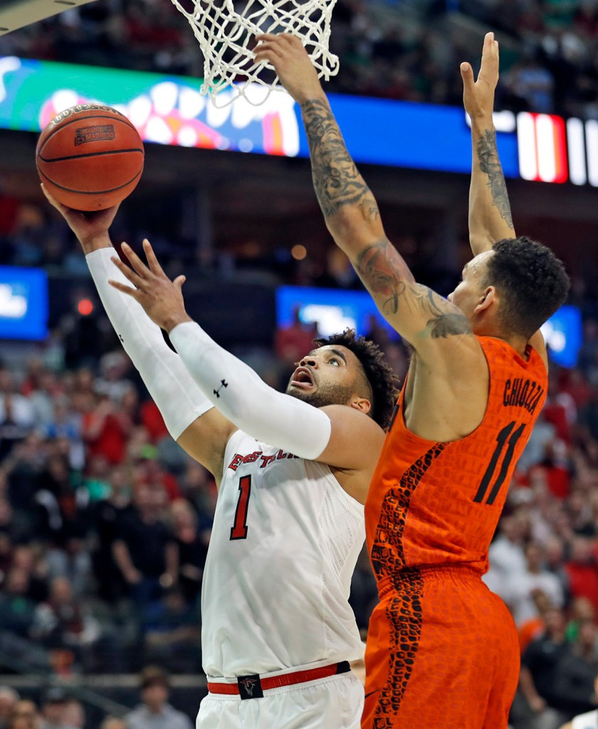 Texas Tech's Brandone Francis (1) lays up the ball around Florida's Chris Chiozza (11) during an NCAA college basketball tournament second-round game Saturday, March 17, 2018, at American Airlines Center in Dallas, Texas. [Brad Tollefson/A-J Media]