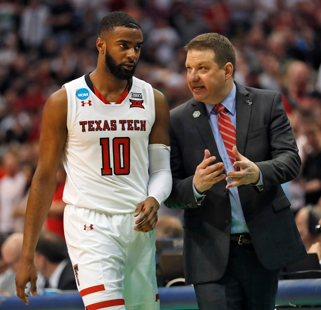 Texas Tech coach Chris Beard talks to Niem Stevenson (10) during an NCAA college basketball tournament second-round game Saturday, March 17, 2018 at American Airlines Center in Dallas, Texas. [Brad Tollefson/A-J Media]