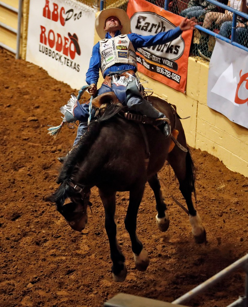 Heith DeMoss (75) rides the saddle bronc during the ABC Pro Rodeo, Friday, March 30, 2018, at Municipal Coliseum in Lubbock, Texas. [Brad Tollefson/A-J Media]
