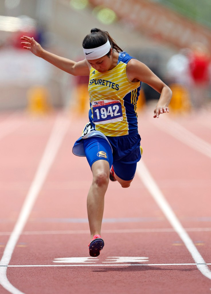 Spur's Danni Uriegas runs down the track in the 100 meter dash during the UIL State Track and Field meet, Saturday, May 12, 2018, at Mike A. Myers Stadium in Austin, Texas. [Brad Tollefson/A-J Media]