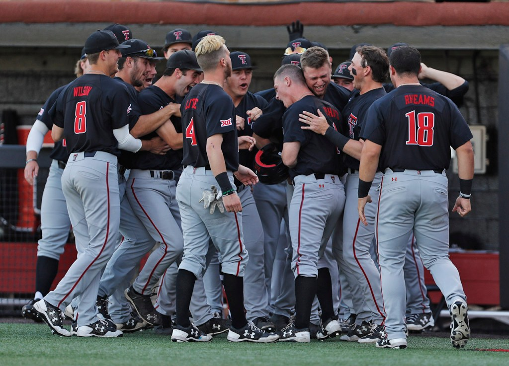 Texas Tech players celebrate after Cody Farhat (1) hit a home run during an NCAA college baseball tournament regional game against LouisvilleSunday, June 3, 2018, in Lubbock, Texas. [Brad Tollefson/A-J Media]
