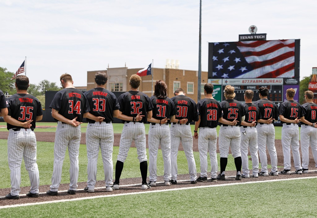Texas Tech players stand for the national anthem before an NCAA college baseball tournament super regional game against Duke, Saturday, June 9, 2018, in Lubbock, Texas. [Brad Tollefson/A-J Media]