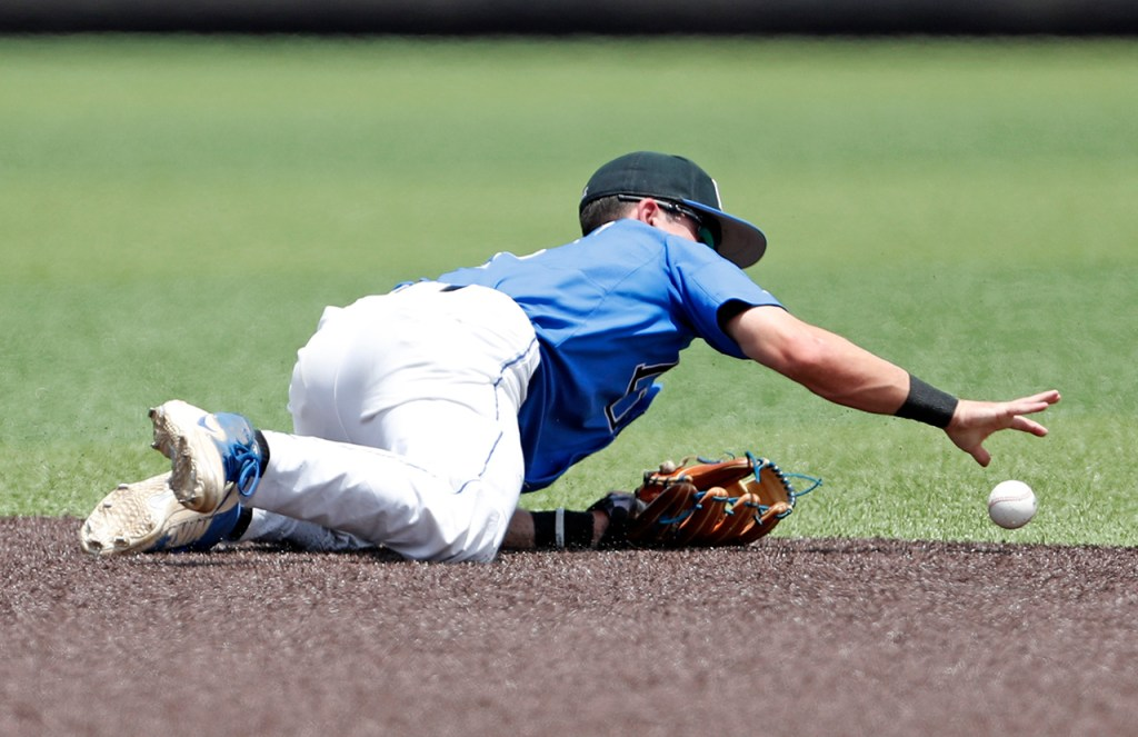 Duke's Max Miller (5) grabs the dropped ground ball during an NCAA college baseball tournament super regional game against Texas Tech, Saturday, June 9, 2018, in Lubbock, Texas. [Brad Tollefson/A-J Media]