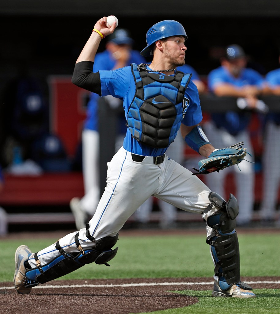 Duke's Chris Proctor (23) throws the ball to second base during an NCAA college baseball tournament super regional game against Texas Tech, Saturday, June 9, 2018, in Lubbock, Texas. [Brad Tollefson/A-J Media]