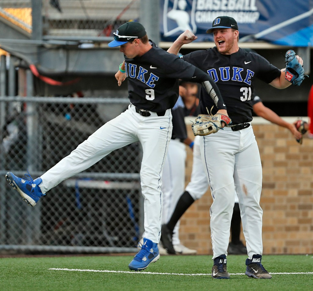 Duke's Griffin Conine (9) and Graeme Stinson (31) celebrate during an NCAA college baseball tournament super regional game against Texas Tech, Sunday, June 10, 2018, in Lubbock, Texas. [Brad Tollefson/A-J Media]