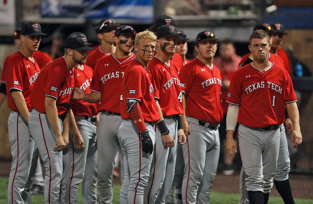 Texas Tech players stand together after an NCAA college baseball tournament super regional game against Duke, Sunday, June 10, 2018, in Lubbock, Texas. [Brad Tollefson/A-J Media]
