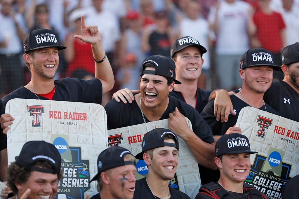 Texas Tech players pose for pictures after an NCAA college baseball tournament super regional game against Duke, Monday, June 11, 2018, in Lubbock, Texas. [Brad Tollefson/A-J Media]