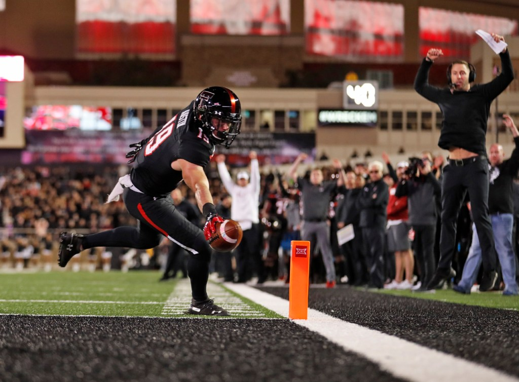 Texas Tech's Zach Austin (19) scores a touchdown during the second half of an NCAA college football game against Oklahoma, Saturday, Nov. 3, 2018, in Lubbock, Texas. (AP Photo/Brad Tollefson)