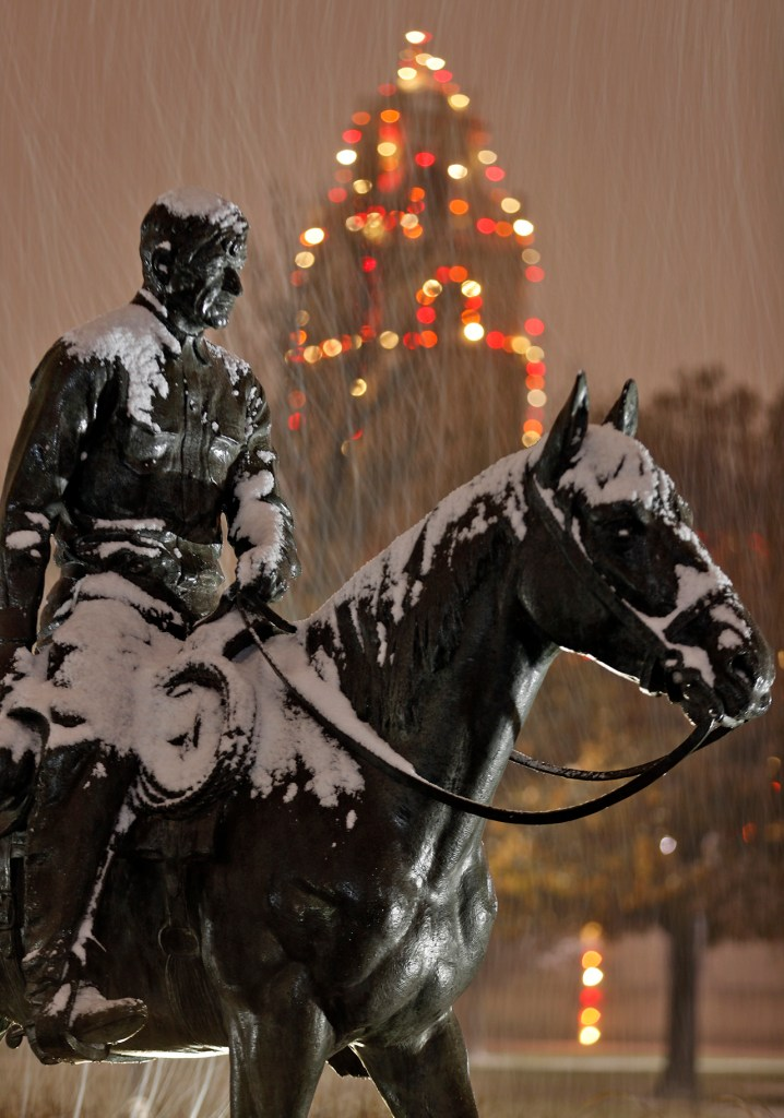 Snow falls on the statue of Will Rogers and Soapsuds, Saturday, Dec. 8, 2018, at Texas Tech in Lubbock, Texas. [Brad Tollefson/A-J Media]