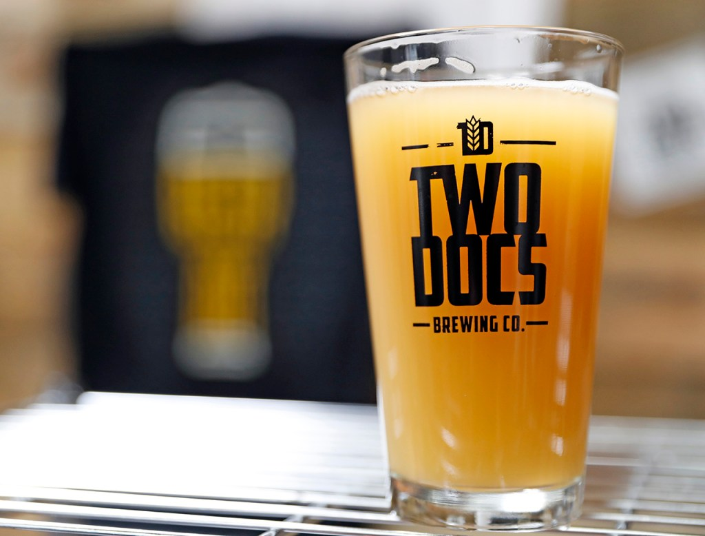 A glass of the End of the Street Wheat beer on opening day Friday, Feb. 1, 2019, at Two Docs Brewing Company in Lubbock, Texas. [Brad Tollefson/A-J Media]