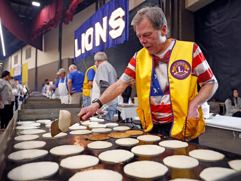 Addison Gradel flips a pancake during the Lubbock Lions Club Pancake Festival, Saturday, Feb. 16, 2019, at Lubbock Memorial Civic Center in Lubbock, Texas. [Brad Tollefson/A-J Media]