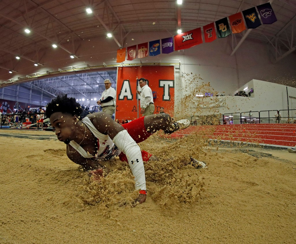 Texas Tech's Charles Brown lands in the sand pit during the long jump competition during the Big 12 indoor track and field championships Friday, Feb. 22, 2019, at the Sports Performance Center in Lubbock, Texas. [Brad Tollefson/A-J Media]