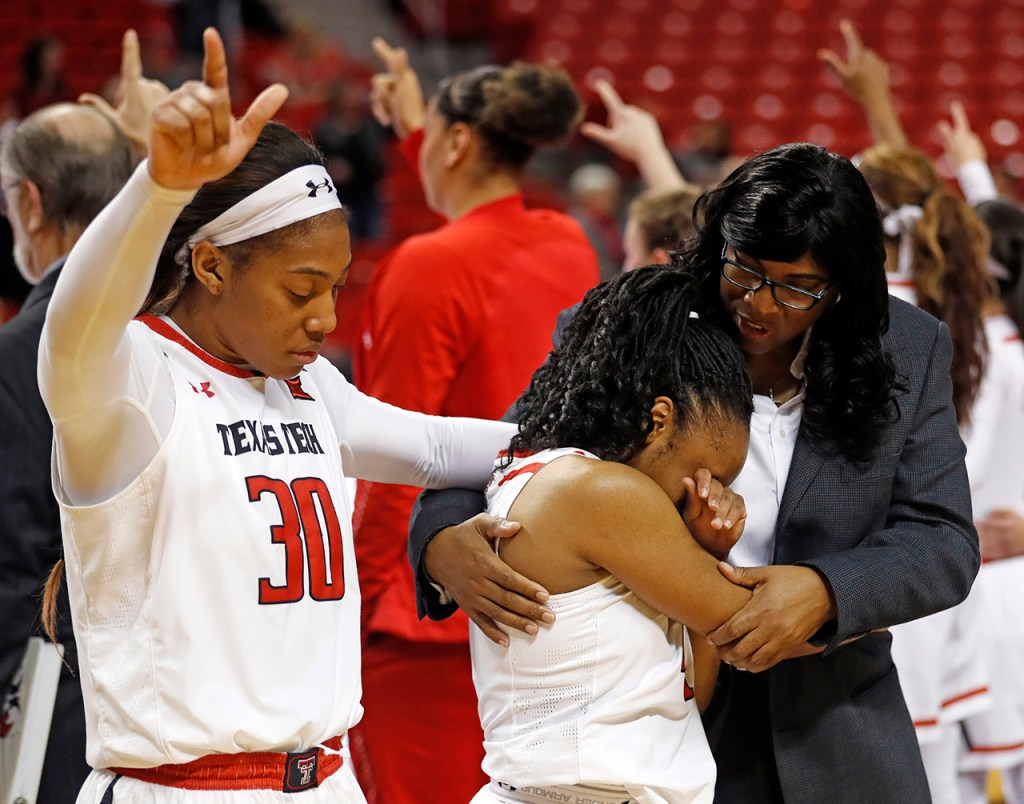 Texas Tech assistant coach Nikita Lowry Dawkins holds Chrislyn Carr (4) after she missed a potential game-winning shot after an NCAA college basketball game against Iowa State, Tuesday, Feb. 26, 2019, in Lubbock, Texas. [Brad Tollefson/A-J Media]