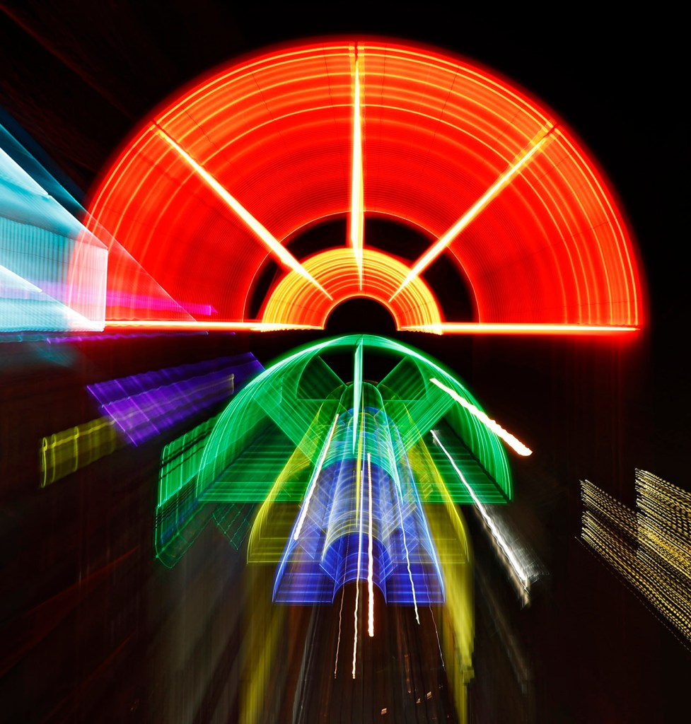 A long exposure shutter pull of the rainbow neon lights in the Depot District, Friday, March 1, 2019, in Lubbock, Texas. [Brad Tollefson/A-J Media]