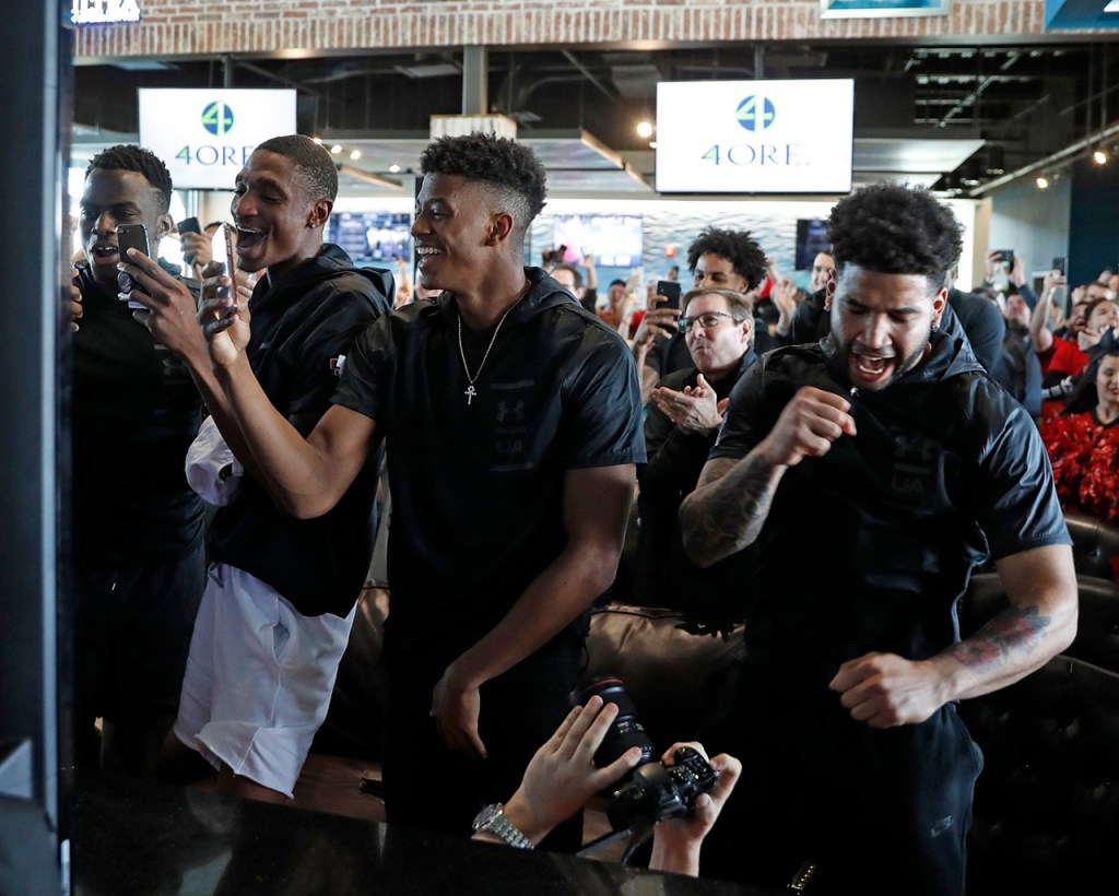 Texas Tech players celebrate after learning their seed during a watch party for the NCAA college basketball tournament selection show Sunday, March 17, 2019, in Lubbock, Texas. [Brad Tollefson/A-J Media]
