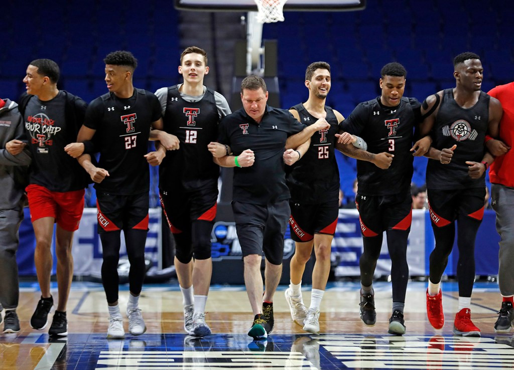 Texas Tech coach Chris Beard runs down the court with his team during practice before the game against Northern Kentucky, Thursday, March 21, 2019, at BOK Center in Tulsa, Okla. [Brad Tollefson/A-J Media]