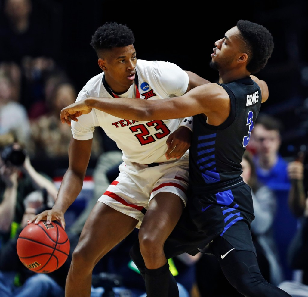 Texas Tech's Jarrett Culver (23) pushes away Buffalo's Jayvon Graves (3) during the NCAA tournament second round game Sunday, March 24, 2019, at BOK Center in Tulsa, Okla. [Brad Tollefson/A-J Media]
