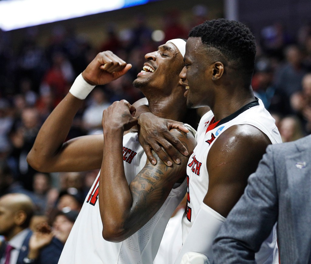 Texas Tech's Norense Odiase (32) and Tariq Owens (11) celebrate during the NCAA tournament second round game against Buffalo, Sunday, March 24, 2019, at BOK Center in Tulsa, Okla. [Brad Tollefson/A-J Media]