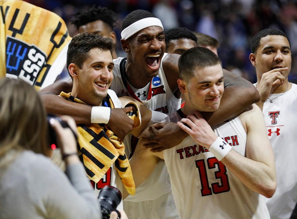 Texas Tech's Davide Moretti (25), Tariq Owens (11) and Matt Mooney (13) celebrate after the NCAA tournament second round game against Buffalo, Sunday, March 24, 2019, at BOK Center in Tulsa, Okla. [Brad Tollefson/A-J Media]