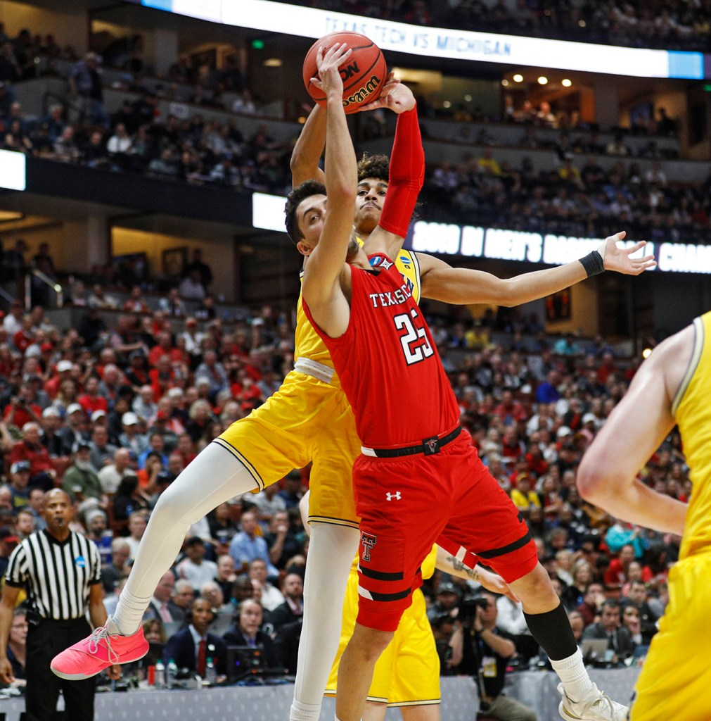 Michigan's Jordan Poole (2) fouls Texas Tech's Davide Moretti (25) during the NCAA tournament Sweet 16 game Thursday, March 28, 2019, at Honda Center in Anaheim, Calif. [Brad Tollefson/A-J Media]