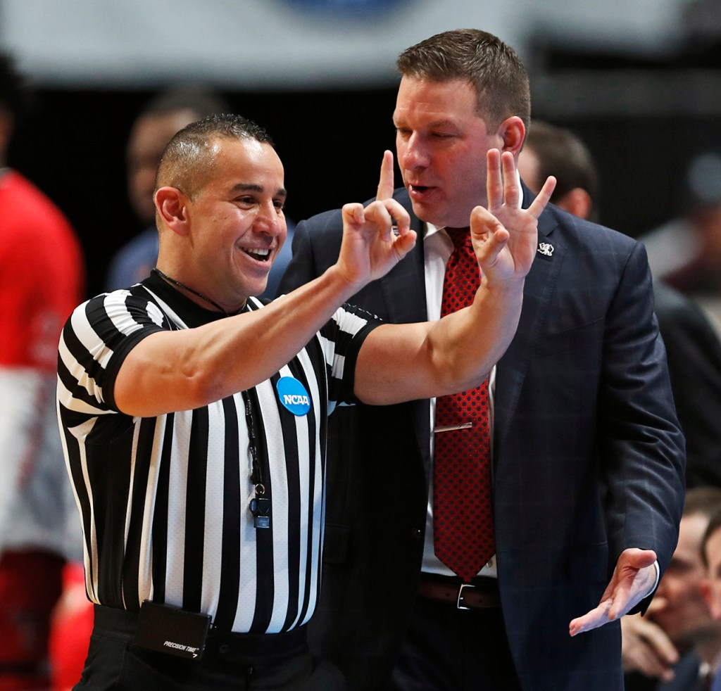 Texas Tech coach Chris Beard reacts as referee Larry Scirotto calls a foul on Matt Mooney (13) during the NCAA tournament Sweet 16 game against Michigan, Thursday, March 28, 2019, at Honda Center in Anaheim, Calif. [Brad Tollefson/A-J Media]