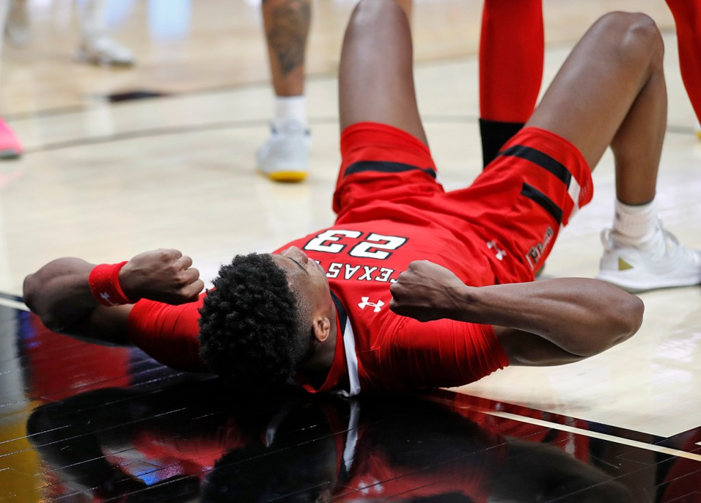 Texas Tech's Jarrett Culver (23) reacts after he is fouled by Michigan's Ignas Brazdeikis (13) during the NCAA tournament Sweet 16 game Thursday, March 28, 2019, at Honda Center in Anaheim, Calif. [Brad Tollefson/A-J Media]