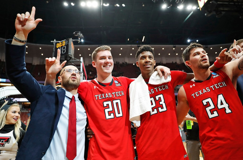 Texas Tech players celebrate on the court after the NCAA tournament Sweet 16 game against Michigan, Thursday, March 28, 2019, at Honda Center in Anaheim, Calif. [Brad Tollefson/A-J Media]