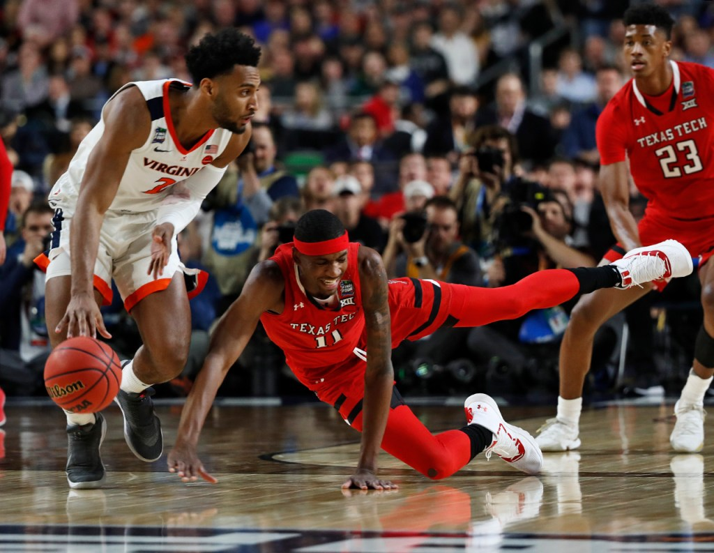Texas Tech's Tariq Owens (11) tries to steal the ball from Virginia's Braxton Key (2) during the men's basketball national championship game against Virginia, Monday, April 8, 2019, at U.S. Bank Stadium in Minneapolis, Minn. [Brad Tollefson/A-J Media]