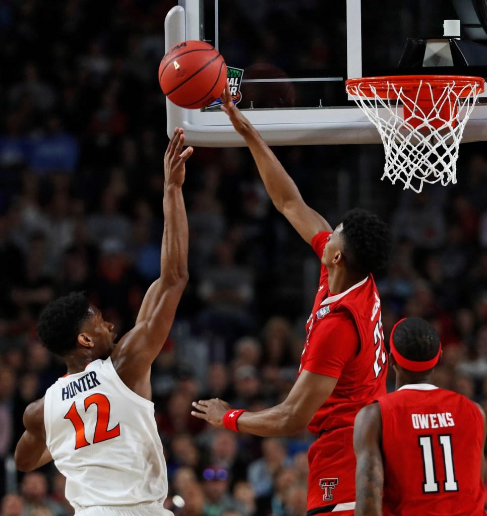Texas Tech's Jarrett Culver (23) blocks a shot by Virginia's De'Andre Hunter (12) during the men's basketball national championship game against Virginia, Monday, April 8, 2019, at U.S. Bank Stadium in Minneapolis, Minn. [Brad Tollefson/A-J Media]