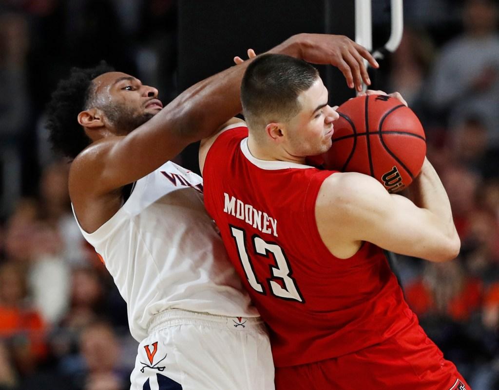 Texas Tech's Matt Mooney (13) steals the ball from Virginia's Braxton Key (2) during the men's basketball national championship against Virginia, Monday, April 8, 2019, at U.S. Bank Stadium in Minneapolis, Minn. [Brad Tollefson/A-J Media]