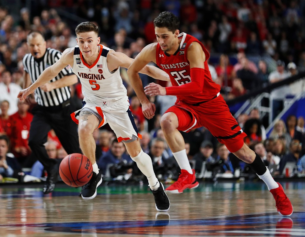Texas Tech's Davide Moretti (25) and Virginia's Kyle Guy (5) run after a loose ball during the men's basketball national championship against Virginia, Monday, April 8, 2019, at U.S. Bank Stadium in Minneapolis, Minn. [Brad Tollefson/A-J Media]