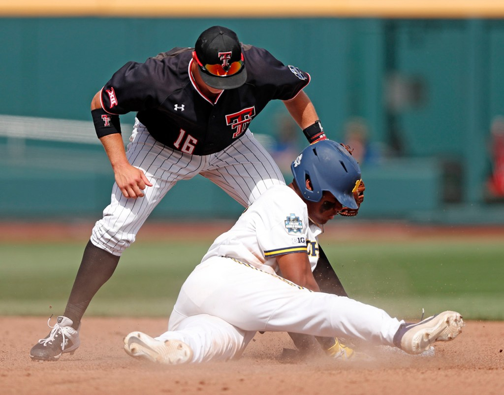 Texas Tech's Josh Jung (16) tags out Michigan's Jordan Nwogu (42) as he slides into second base during the College World Series game against Michigan, Saturday, June 15, 2019, at TD Ameritrade Park in Omaha, Neb. [Brad Tollefson/A-J Media]
