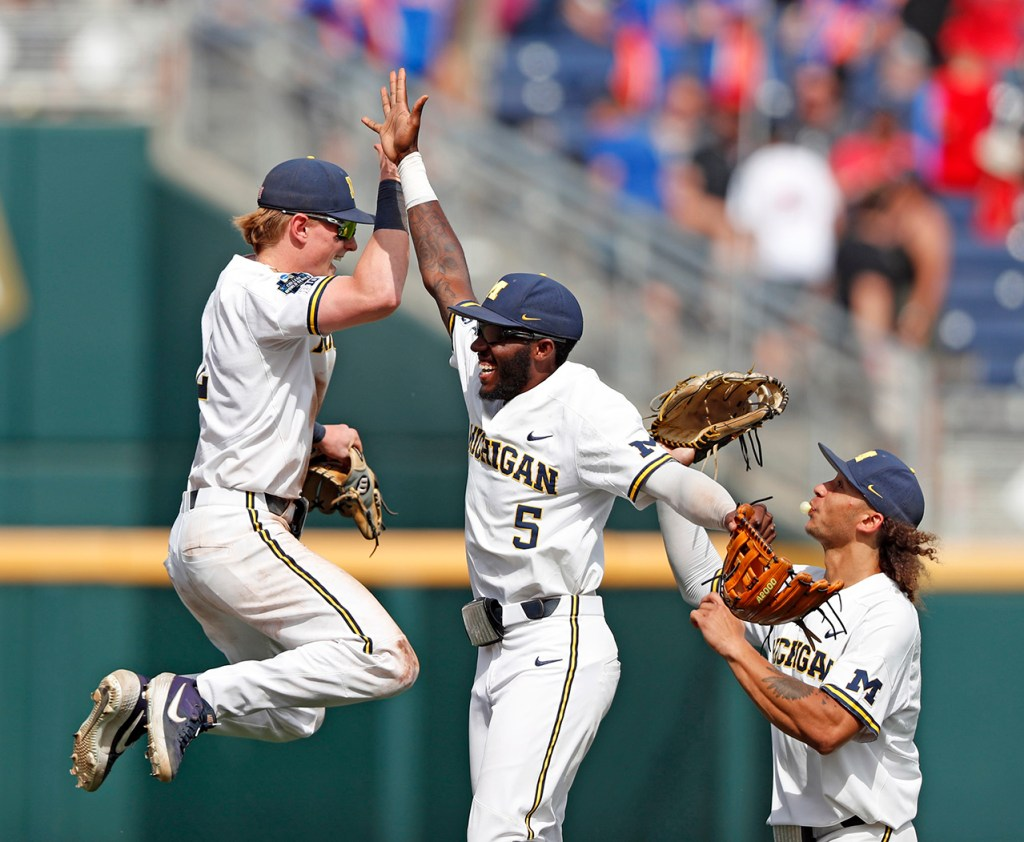 Michigan's Jack Blomgren (2), Danny Zimmerman (6) and Jordan Brewer (22) celebrate after the College World Series game against Texas Tech, Saturday, June 15, 2019, at TD Ameritrade Park in Omaha, Neb. [Brad Tollefson/A-J Media]