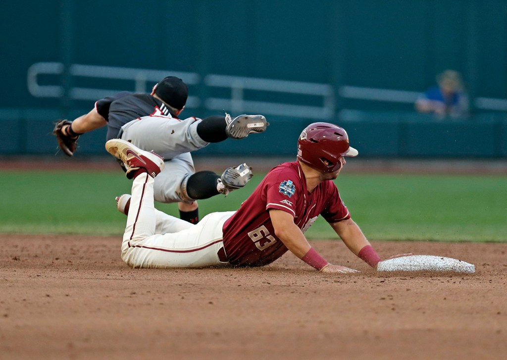 Florida State's Matheu Nelson (63) slides into second base past Texas Tech's Josh Jung (16) during the College World Series game Wednesday, June 19, 2019, at TD Ameritrade Park in Omaha, Neb. [Brad Tollefson/A-J Media]