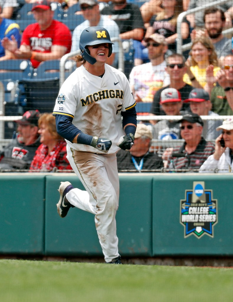 Michigan's Jesse Franklin (7) celebrates after scoring a run during the College World Series game against Texas Tech, Friday, June 21, 2019, at TD Ameritrade Park in Omaha, Neb. [Brad Tollefson/A-J Media]